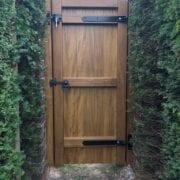 Idigbo village design single gate in mid oak finish rear