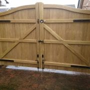 Idigbo Hardwood Swan Neck Driveway Gates in Light Oak rear