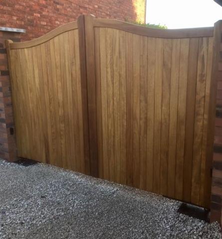 Iroko hardwood driveway gates swan neck design