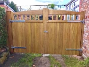 Idigbo-hardwood-Lancashire-design-driveway-gates-in-light-oak-finish