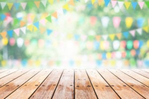 wooden table with multicoloured bunting in the background